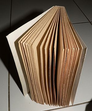 An uncut book after bookbinding from folded pa...