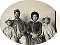 Unidentified African American soldier in Union uniform with wife and two daughters - no frame.jpg