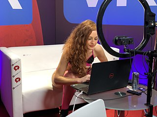 Webcam model video performer who is streamed upon the Internet with a live webcam broadcast