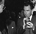 Vice President Richard Nixon drinks yerba mate from a mate gourd at a barbeque luncheon held at the residence of Luis Batlle Berres in Montevideo, Uruguay.jpg