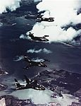 Vought F7U-1, McDonnell F2H-2, Grumman F9F-2 and Vought F6U-1 flying in formation, circa 1950 (NH 101815-KN).jpg