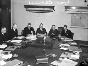 War cabinet - War Cabinet meeting in Melbourne in 1943. Left to right: John Curtin, Sir Frederick Sheddon, Ben Chifley, 'Doc' Evatt, Norm Makin, Arthur Drakeford