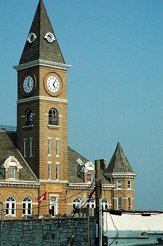 Washington County Courthouse (Arkansas) - The clock steeple was removed in 1965 and returned by helicopter in 1974. The clock face is now illuminated.