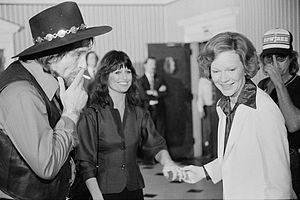 Rosalynn Carter - First Lady Rosalynn Carter (right) with Waylon Jennings (smoking a cigarette) and Jessi Colter at a reception preceding a concert to benefit the Carter-Mondale campaign on April 23, 1980.