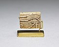 Wedjat Plaque; on opposite side Maat, Re, Upper and Lower Egyptian serpents over nub sign MET 1971.272.14 EGDP019174.jpg