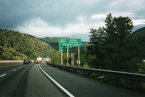 Road signs, like this one on Interstate 70 in Colorado, typically indicate that a weigh station is upcoming, and a signal indicates whether it is open.