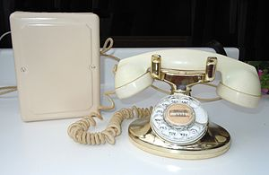 Model 202 telephone - A Western Electric 202 Imperial telephone as issued in 1955 with a gold lacquered base and ivory Tenite plastic F1 handset. The subscriber set was painted in harmonizing color to the desk set.