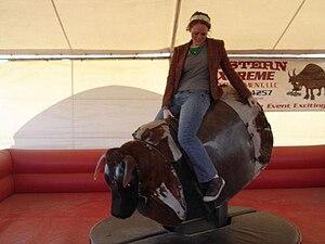 Mechanical bull - A woman riding on a mechanical bull