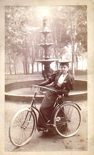 English: Woman with bicycle, 1890s Source: htt...