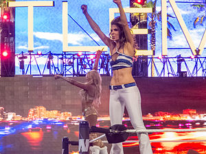 Maria Menounos - Menounos (front) celebrating her victory at WrestleMania XXVIII along with tag-team partner Kelly Kelly in April 2012