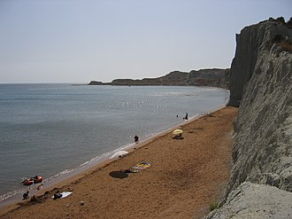 Xi Beach - Xi Beach with its red sand, backed by white cliffs