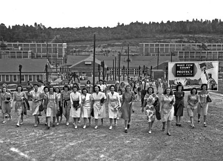 Shift change at the Y-12 uranium enrichment facility at the Clinton Engineer Works in Oak Ridge, Tennessee, on 11 August 1945. By May 1945, 82,000 people were employed at the Clinton Engineer Works. Photograph by the Manhattan District photographer Ed Westcott. Y-12 Shift Change.jpg