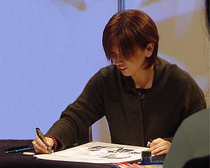 Yuu Watase - Yuu Watase illustrating a sample of Ayashi no Ceres at Lucca Comics 2004 in Italy