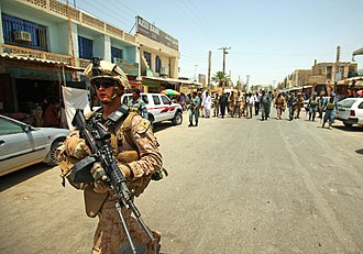 Zaranj - Afghan and US officials walking on one of the main streets of Zaranj