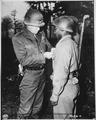 """Lt. Gen. George S. Patton, U.S. Third Army commander, pins the Silver Star on Private Ernest A. Jenkins of New York Cit - NARA - 535724.tif"