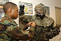(L to R) SrA Bernard Harper, a Readiness Journeyman for the 31st Civil Engineer Squadron assists SrA Christopher C. Croley, an Aircraft Armorment Journeyman for the 31st Aircraft Maintenance Squadron 031007-F-RX586-005.jpg