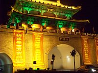 A picture of a modern day reconstruction of a Bianjing city gate, in Bianjing's old town. The guard tower above the gate is wide and has two stories, different from the historical depictions.