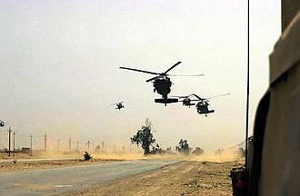 Battle of Baghdad (2003) - Black Hawk helicopters from 5th Battalion, 101st Combat Aviation Brigade, 101st Airborne Division (Air Assault) move into an Iraqi city during an operation to occupy the city, April 5.