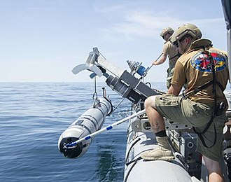 REMUS (AUV) - US Navy sailors lower a REMUS 600 into the water during a mine countermeasures exercise in Panama City, Florida