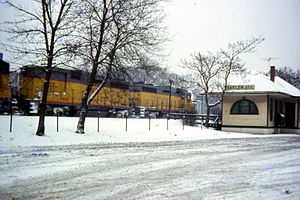 Harlem Avenue station - A freight train led by Union Pacific heads past the station in 1968.