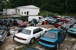 English: A junk yard next to the railroad on E...