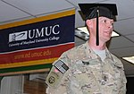 20 years after high school, a soldier graduates 030512-A-SD827-001.jpg