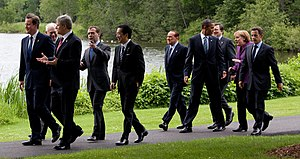 Group of Eight - The G8 leaders at the 36th summit in Huntsville, Ontario. Left to right: Cameron, Van Rompuy (European Council), Harper, Medvedev, Kan, Berlusconi, Obama, Barroso (European Commission), Merkel, Sarkozy.
