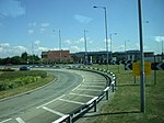 A127/B1013 junction A slip road attached to a roundabout on the A127 towards Southend taken on a moving coach.