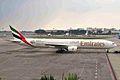 A6-EMX B777-31H Emirates (World Cup 2006 logo) SIN 02APR06 (6770893889).jpg