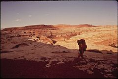 A Hiker in the Maze, a Remote and Rugged Region in the Heart of the Canyonlands, 05-1972 (3814975060).jpg