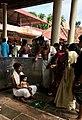 A Hindu family at baby first solid food eating Annaprashana samskara rite-of-passage ceremony inside Shiva temple Kerala.jpg