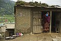 A Nepali woman drinks water from a pitcher in a doorway in Kathmandu, Nepal 120907-F-CP197-890 (7956884736).jpg