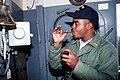 A boatswain's mate uses a boatswain's pipe to make a call over the 1MC circuit aboard the battleship USS MISSOURI (BB-63) - DPLA - 2dd91535e05fc3a5d6bfd38db7f13ad7.jpeg