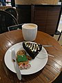 A cappuccino with gingerbread men and chocolate christmas tree.jpg