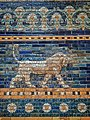 A lion on the Ishtar Gate of Babylon reconstructed with original bricks at the Pergamon Museum in Berlin 575 BCE (2) (32577952766).jpg