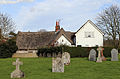 A listed cottage at Fyfield, Essex, England - Walker's Cottage, south-east from the church, with churchyard 01.jpg