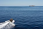 A rigid-hull inflatable boat leaves the amphibious transport dock ship USS Denver (LPD 9), not shown, to conduct a personnel transfer with the amphibious assault ship USS Bonhomme Richard (LHD 6) in the Coral 130806-N-KL846-015.jpg
