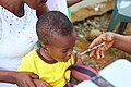 A young boy taking after an injection 1.jpg