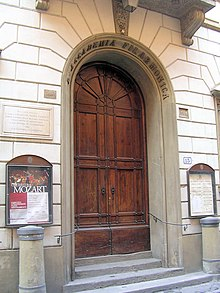 a picture of an arched doorway with heavy wooden doors