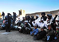 Afghan villagers wait to receive cold weather materials and clothes from Afghan Local Police and coalition special operation forces in Nawbahar district, Zabul province, Afghanistan Nov. 6, 2011 111106-N-AT856-036.jpg