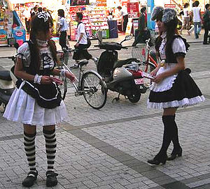Cosplay restaurant - Maids promoting cafes in Akihabara, Tokyo