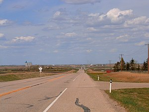 Alberta Highway 2A - Highway 2A north of Crossfield in the foreground with divided Highway 2 in the distance.