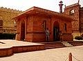 Allama Iqbal Tomb adjacent to the Badshahi Mosque's gateway.jpg