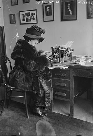 Amelita Galli-Curci - Amelita Galli-Curci typing in a fur coat, circa 1920. Forms part of: George Grantham Bain Collection (Library of Congress).
