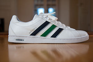 An Adidas shoe with its trademark design-the t...