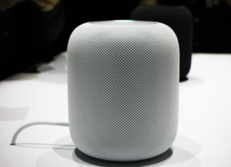 A white HomePod on display An Apple HomePod speaker .png