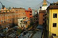 An alternate view of Boudha Stupa, above the rooftops and alley, from a Sakya School Residence Hall for monks, nuns and lay practitioners of Tibetan Buddhism, Boudhanath, Kathmandu, Nepal (5345845006).jpg