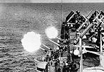 Anti-aircraft guns firing aboard USS Oriskany (CVA-34), in 1956.jpg