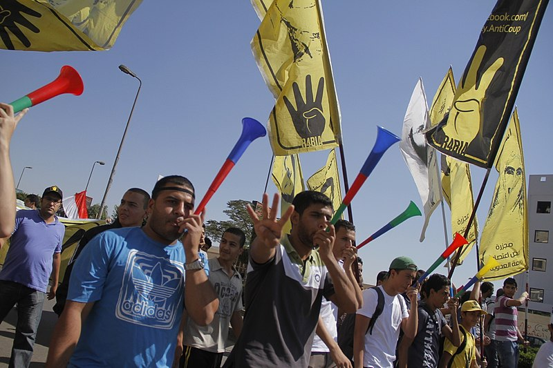 Anti-coup protesters with R4bia sign in Nasr City-Cairo 11-Oct-2013.jpg