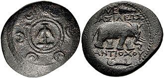 Antiochus I Soter - Antiochos I coin. Antioch mint. Macedonian shield with Seleucid anchor in central boss. Elephant walking right.